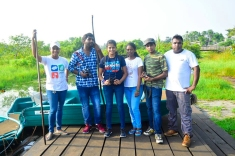 Students pose on the pier after the successful retrieval of a trap cage