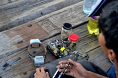 Equipment used for small wild cat conservation (collars, cameras and jars of fishing cat scat)