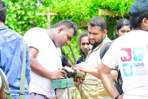 Maduranga teaching the group how to use a camera trap